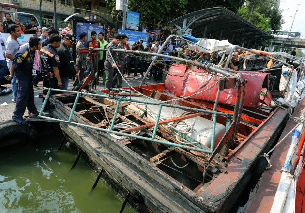 epa05195541 Thai police officers and officials inspect a taxi boat after its engine exploded, at Wat Thep Leela pier in Bangkok, Thailand, 05 March 2016. A large gas explosion on a passenger boat in the Saensaep canal in eastern Bangkok on 05 March 2016 morning, has injured at least 50 passengers, media reported. The boat, loaded with more than 60 passengers, was sailing from Wat Sribunruang Temple to Pratunam on its first trip of the day, when an explosion rocked the engine room as the boat was about to dock at Wat Thep Leela pier. The injured passengers were admitted to local hospitals, with two people in serious condition. The boat's gas tanks, which contained LNG gas, were intact after the blast but the engine room was badly damaged, an inspection found. Chavalit Maetayaprapas, CEO of the boat operating company Krobkrua Khonsong, said today's accident was the first of its kind in almost 30 years of service. EPA/NARONG SANGNAK