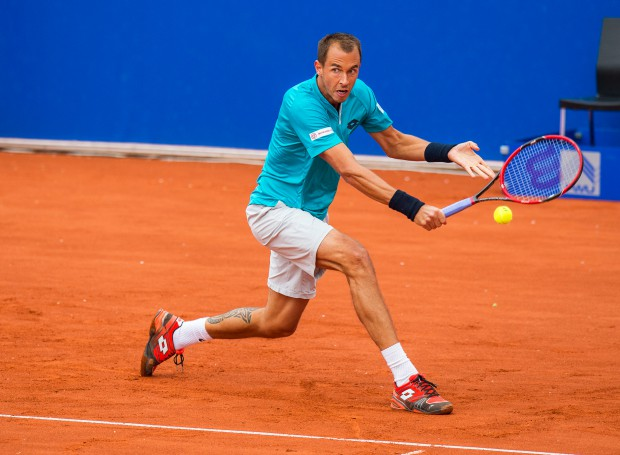 epa04724268 Lukas Rosol of the Czech Republic returns the ball to Florian Mayer of Germany during their first round match of the ATPtennis tournament in Munich, Germany, 28 April 2015. EPA/MARCMUELLER