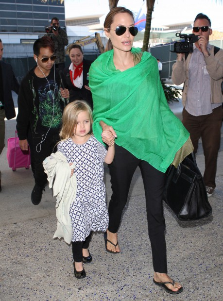 51322419 Actors Brad Pitt and Angelina Jolie arrive on a flight with all of their kids at LAX Airport on February 5, 2014 in Los Angeles, California. The family is returning from Australia, where they had just thrown a huge wrap party for Jolie's film