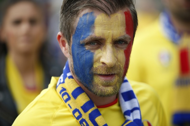 epa05355308 A Romanian fan outside the stadium before the UEFA EURO 2016 group A preliminary round match between France and Romania at Stade de France in Saint-Denis, France, 10 June 2016. (RESTRICTIONS APPLY: For editorial news reporting purposes only. Not used for commercial or marketing purposes without prior written approval of UEFA. Images must appear as still images and must not emulate match action video footage. Photographs published in online publications (whether via the Internet or otherwise) shall have an interval of at least 20 seconds between the posting.) EPA/YOAN VALAT EDITORIAL USE ONLY