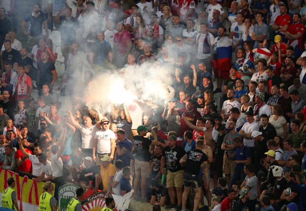 epa05358405 Russian fans light flares during the UEFA EURO 2016 group B preliminary round match between England and Russia at Stade Velodrome in Marseille, France, 11 June 2016. The match ended 1-1. (RESTRICTIONS APPLY: For editorial news reporting purposes only. Not used for commercial or marketing purposes without prior written approval of UEFA. Images must appear as still images and must not emulate match action video footage. Photographs published in online publications (whether via the Internet or otherwise) shall have an interval of at least 20 seconds between the posting.) EPA/ALI HAIDER EDITORIAL USE ONLY