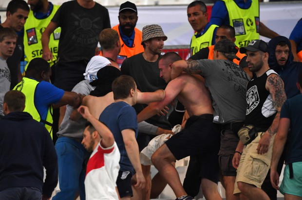 epa05358426 Supporters clash in the stands during the UEFA EURO 2016 group B preliminary round match between England and Russia at Stade Velodrome in Marseille, France, 11 June 2016. (RESTRICTIONS APPLY: For editorial news reporting purposes only. Not used for commercial or marketing purposes without prior written approval of UEFA. Images must appear as still images and must not emulate match action video footage. Photographs published in online publications (whether via the Internet or otherwise) shall have an interval of at least 20 seconds between the posting.) EPA/PETER POWELL EDITORIAL USE ONLY