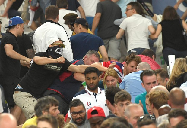 epa05358463 Supporters clash in the stands after the UEFA EURO 2016 group B preliminary round match between England and Russia at Stade Velodrome in Marseille, France, 11 June 2016. (RESTRICTIONS APPLY: For editorial news reporting purposes only. Not used for commercial or marketing purposes without prior written approval of UEFA. Images must appear as still images and must not emulate match action video footage. Photographs published in online publications (whether via the Internet or otherwise) shall have an interval of at least 20 seconds between the posting.) EPA/DANIEL DAL ZENNARO EDITORIAL USE ONLY