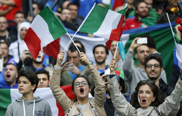 epa05362516 Supporters of Italy cheer prior to the UEFA EURO 2016 group E preliminary round match between Belgium and Italy at Stade de Lyon in Lyon, France, 13 June 2016. (RESTRICTIONS APPLY: For editorial news reporting purposes only. Not used for commercial or marketing purposes without prior written approval of UEFA. Images must appear as still images and must not emulate match action video footage. Photographs published in online publications (whether via the Internet or otherwise) shall have an interval of at least 20 seconds between the posting.) EPA/SERGEY DOLZHENKO EDITORIAL USE ONLY