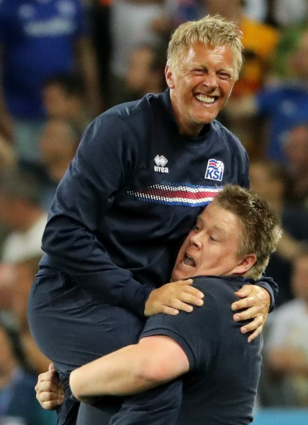 epa05395444 Iceland's coach Heimir Hallgrimsson (L) reacts at the end of the UEFA EURO 2016 round of 16 match between England and Iceland at Stade de Nice in Nice, France, 27 June 2016. Iceland won the match 2-1. (RESTRICTIONS APPLY: For editorial news reporting purposes only. Not used for commercial or marketing purposes without prior written approval of UEFA. Images must appear as still images and must not emulate match action video footage. Photographs published in online publications (whether via the Internet or otherwise) shall have an interval of at least 20 seconds between the posting.) EPA/OLIVER WEIKEN EDITORIAL USE ONLY