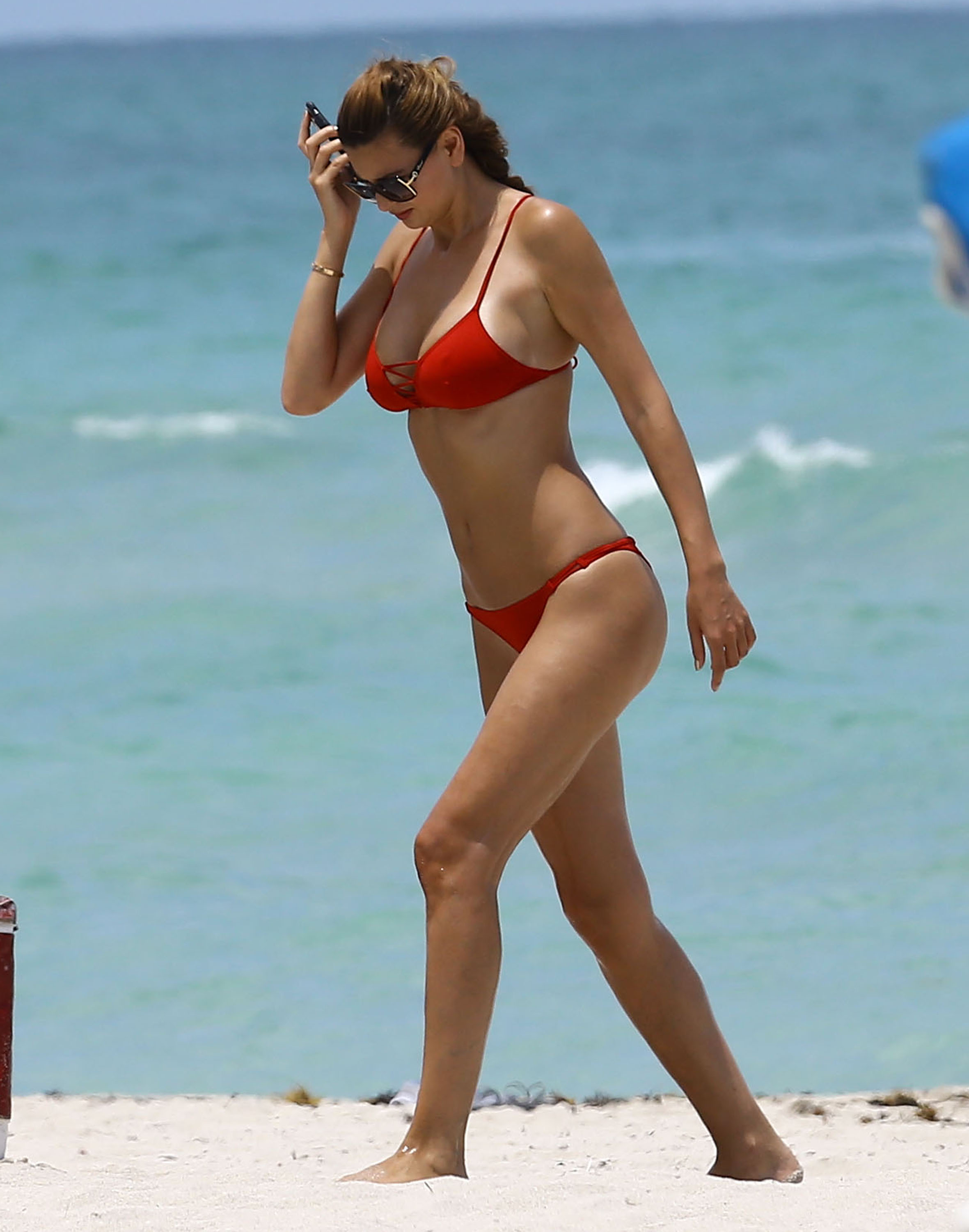 52118749 Romanian socialite Ramona Gabor enjoys a day on the beach in Miami, Florida on July 11, 2016. Ramona showed off her toned body in a red bikini. FameFlynet, Inc - Beverly Hills, CA, USA - +1 (310) 505-9876