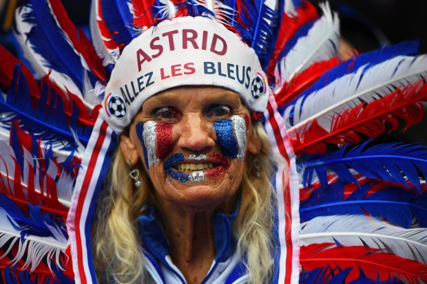 epa05405952 A French fan smiles before the UEFA EURO 2016 quarter final match between France and Iceland at Stade de France in Saint-Denis, France, 03 July 2016. (RESTRICTIONS APPLY: For editorial news reporting purposes only. Not used for commercial or marketing purposes without prior written approval of UEFA. Images must appear as still images and must not emulate match action video footage. Photographs published in online publications (whether via the Internet or otherwise) shall have an interval of at least 20 seconds between the posting.) EPA/FILIP SINGER EDITORIAL USE ONLY