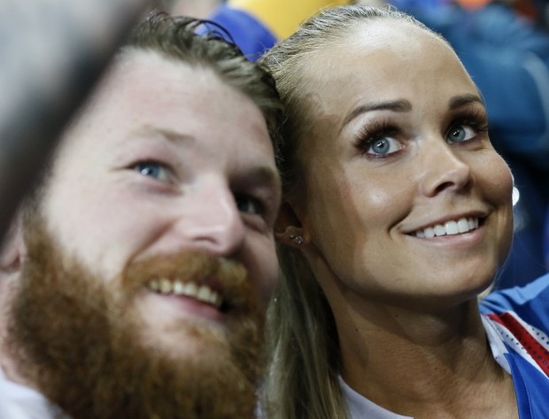 epa05406436 Aron Gunnarsson (L) of Iceland and his partner Kristbjoerg Jonasdottir at the end of the UEFA EURO 2016 quarter final match between France and Iceland at Stade de France in Saint-Denis, France, 03 July 2016. Iceland lost the match 2-5. (RESTRICTIONS APPLY: For editorial news reporting purposes only. Not used for commercial or marketing purposes without prior written approval of UEFA. Images must appear as still images and must not emulate match action video footage. Photographs published in online publications (whether via the Internet or otherwise) shall have an interval of at least 20 seconds between the posting.) EPA/ETIENNE LAURENT EDITORIAL USE ONLY