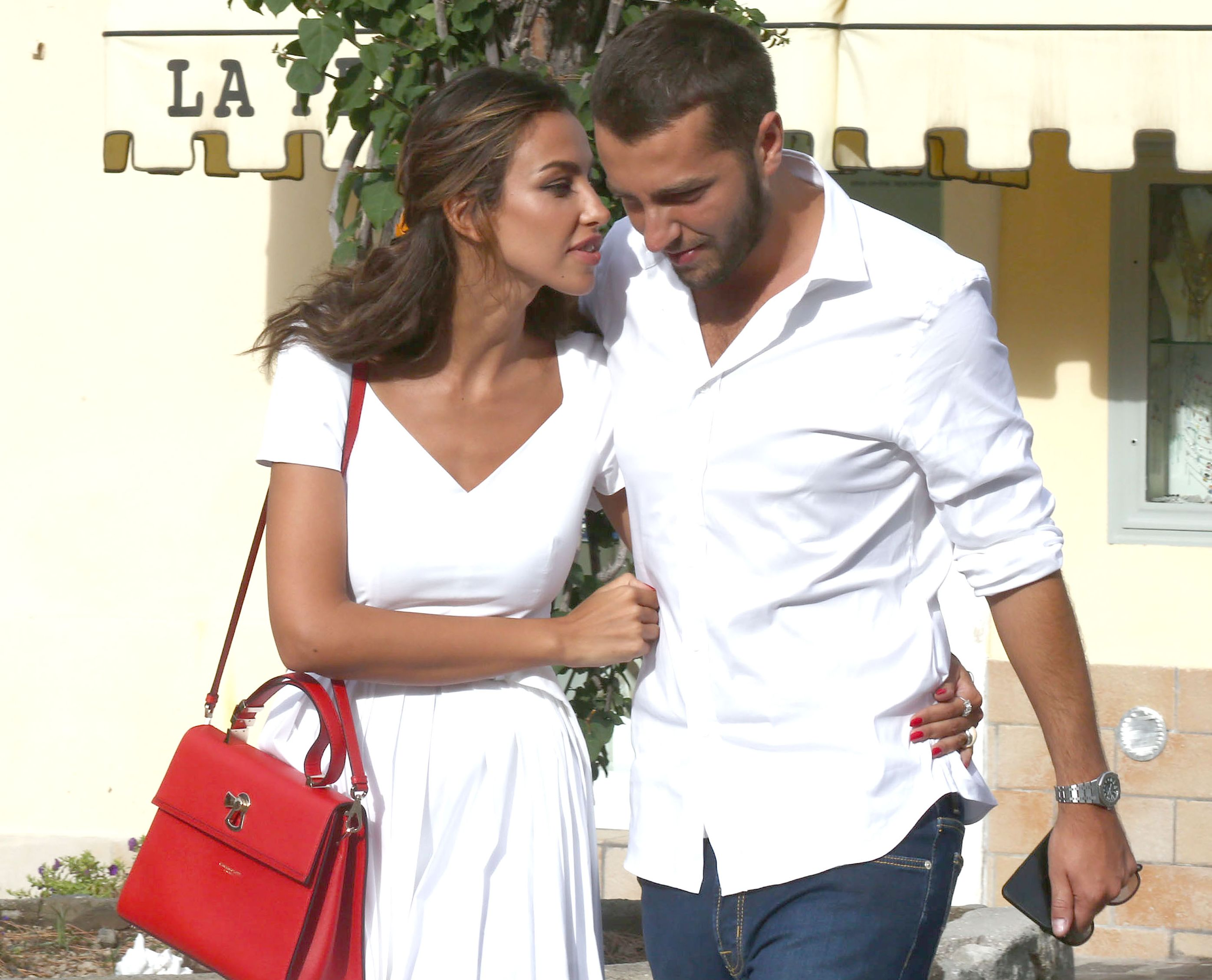 Aesthetic operations by Madalina Ghenea. Brunette, next to her new boyfriend
