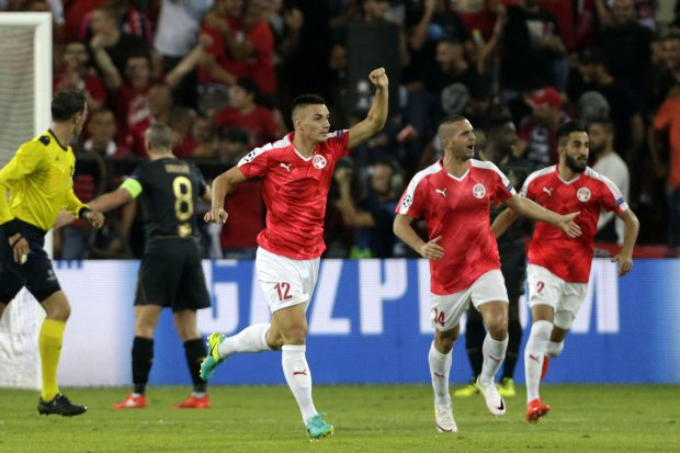 epa05507916 Hapoel Beer Sheva's Ovidiu Hoban (C) celebrates after scoring the 2-0 goal during the UEFA Champions League qualification playoff round second leg match between Hapoel Beer Sheva and Celtic at Turner Stadium in Beer Sheva, Israel, 23 August 2016. EPA/ABIR SULTAN