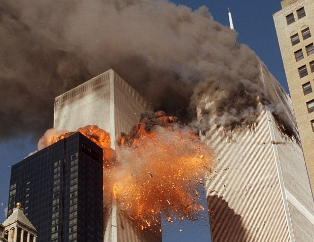 ** FOR USE AS DESIRED WITH SEPT. 11 ANNIVERSARY STORIES--FILE **Smoke billows from one of the towers of the World Trade Center and flames as debris explodes from the second tower, in this Sept. 11, 2001, file photo. In one of the most horrifying attacks ever against the United States, terrorists crashed two airliners into the World Trade Center in a deadly series of blows that brought down the twin 110-story towers. This year will mark the fifth anniversary of the attacks. (AP Photo/Chao Soi Cheong/FILE)