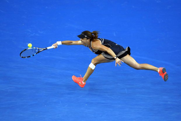 epa05115466 Alexandra Dulgheru of Romania in action against Angelique Kerber of Germany during their second round match at the Australian Open Grand Slam tennis tournament in Melbourne, Australia, 21 January 2016. EPA/MAST IRHAM