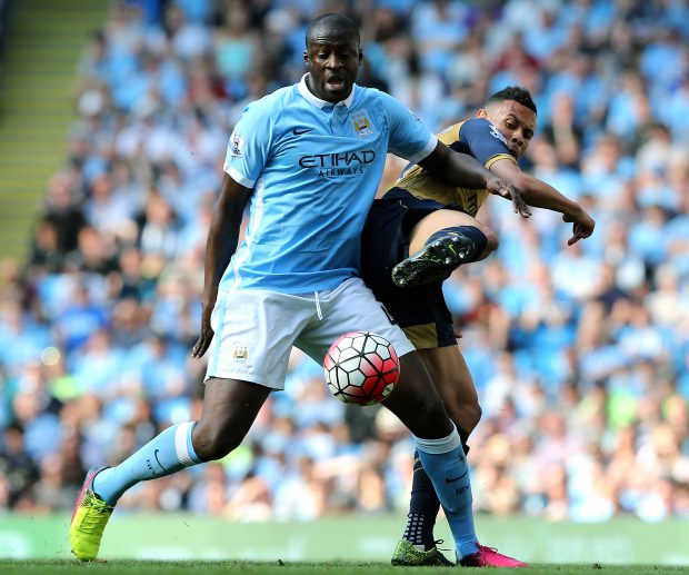 epa05295200 Yaya Toure (L) of Manchester City in action against Arsenal's Kieran Gibbs (R) during the English Premier League soccer match between Manchester City and Arsenal at the Etihad Stadium, Manchester, Britain, 8 May 2016. EPA/Nigel Roddis EDITORIAL USE ONLY. No use with unauthorized audio, video, data, fixture lists, club/league logos or 'live' services. Online in-match use limited to 75 images, no video emulation. No use in betting, games or single club/league/player publications.