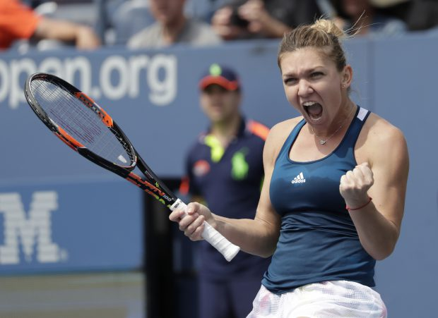 epa05525773 Simona Halep of Romania reacts after defeating Carla Suarez Navarro of Spain on the eighth day of the US Open Tennis Championships at the USTA National Tennis Center in Flushing Meadows, New York, USA, 05 September 2016. The US Open runs through September 11. EPA/PETER FOLEY
