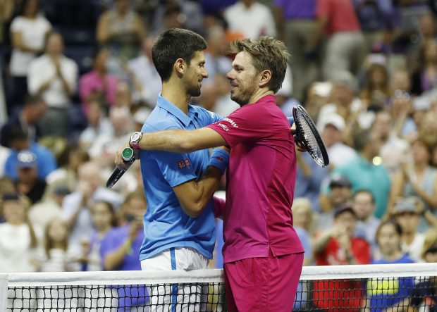 epa05535722 Stan Wawrinka of Switzerland (R) and Novak Djokovic of Serbia embrace at the net after the men's final on the final day of the US Open Tennis Championships at the USTA National Tennis Center in Flushing Meadows, New York, USA, 11 September 2016. The US Open runs through September 11. EPA/JOHN G. MABANGLO