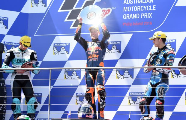 epa05598705 Brad Binder of South Africa for Red Bull KTM Ajo (C) celebrates after winning the Moto3 class race during the 2016 Australian MotoGP at Phillip Island, Victoria, Australia, 23 October 2016. In picture are seen second placed Andrea Locatelli of Italy for Leopard Racing (L) and third placed Aron Canet of Spain for Estrella Calicia 0,0 (R). EPA/TRACEY NEARMY AUSTRALIA AND NEW ZEALAND OUT