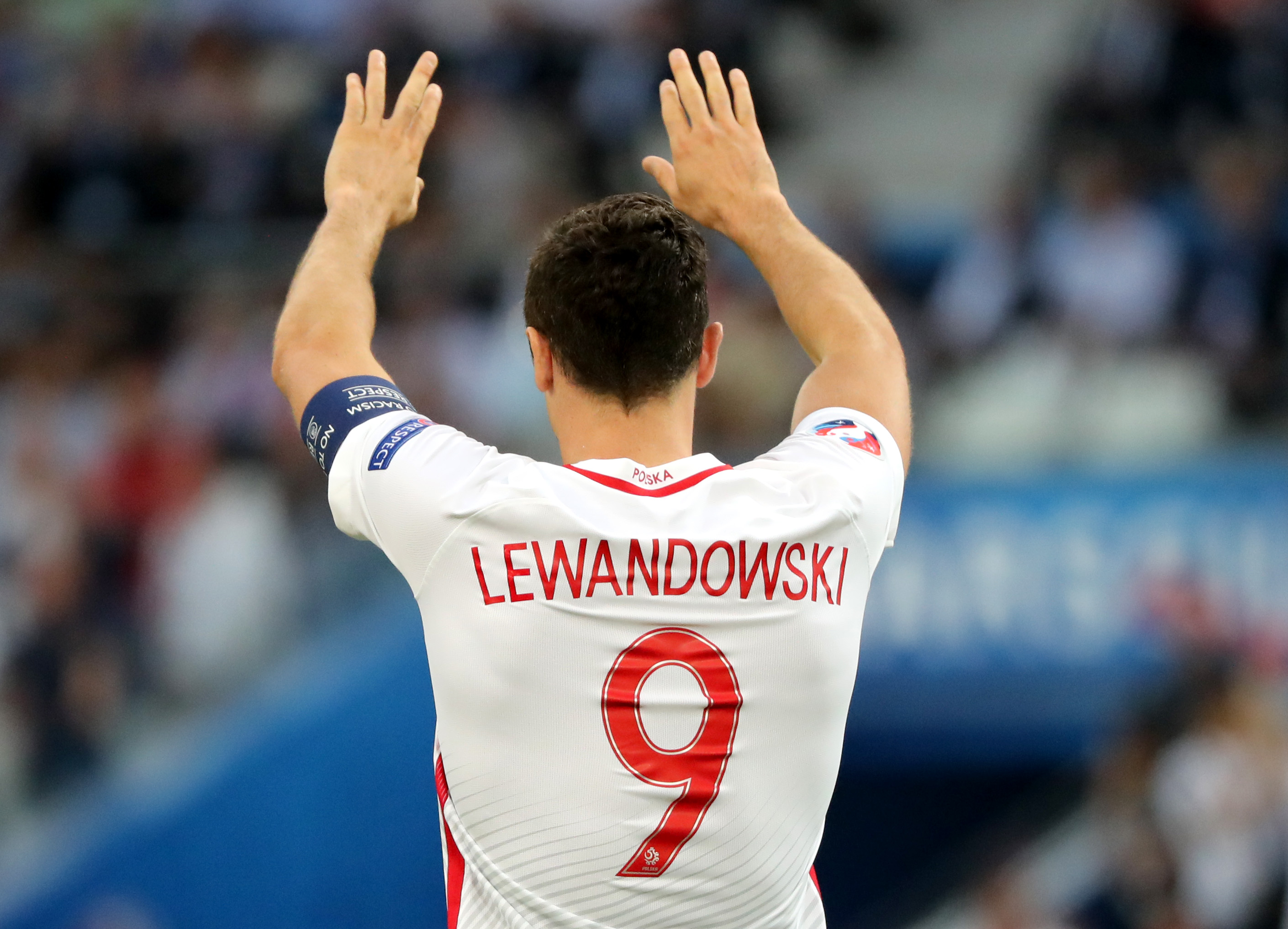 epa05399721 Robert Lewandowski of Poland celebrates after scoring the 1-0 goal during the UEFA EURO 2016 quarter final match between Poland and Portugal at Stade Velodrome in Marseille, France, 30 June 2016. (RESTRICTIONS APPLY: For editorial news reporting purposes only. Not used for commercial or marketing purposes without prior written approval of UEFA. Images must appear as still images and must not emulate match action video footage. Photographs published in online publications (whether via the Internet or otherwise) shall have an interval of at least 20 seconds between the posting.) EPA/OLIVER WEIKEN EDITORIAL USE ONLY