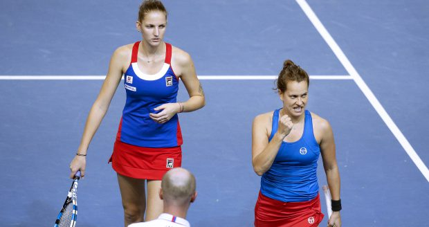 epa05630249 Barbora Strycova (R) and Karolina Pliskova (L) of the Czech Republic react during their doubles match against Caroline Garcia and Kristina Mladenovic of France at the Fed Cup Tennis World Group final between France and the Czech Republic at the Rhenus Sport stadium in Strasbourg, France, 13 November 2016.  EPA/YOAN VALAT