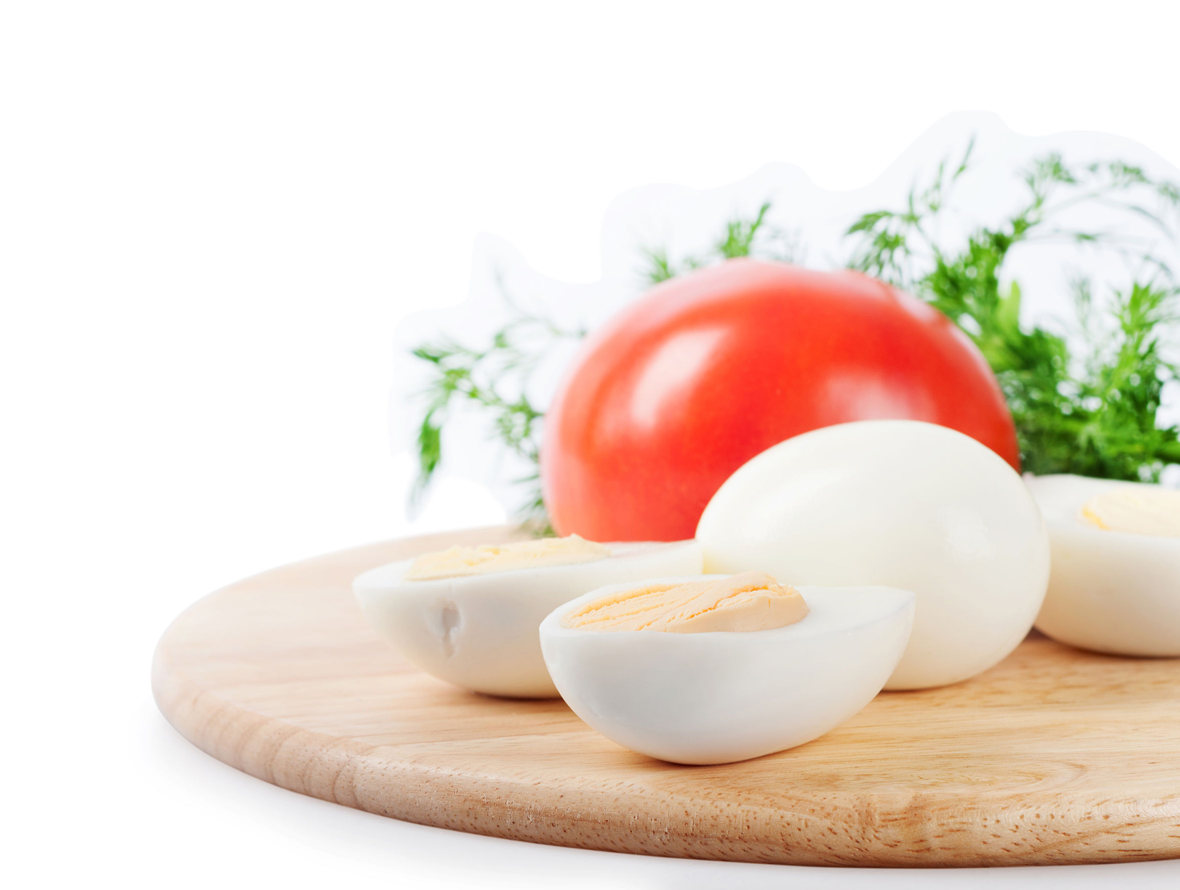 59849896 - boiled hen eggs and tomato on a white background