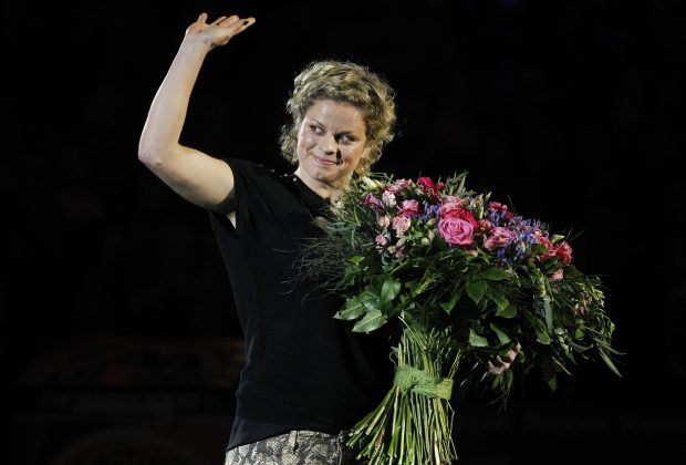 epa03506425 Former world number one Kim Clijsters waves to the crowd during the Kim's Thank You Games at the Sportpaleis, in Antwerp, Belgium, 12 December 2012. Kim Clijsters played her farewell single match against U.S. Venus William during a show celebrating her career. EPA/THIERRY ROGE