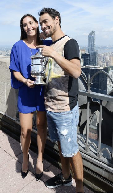 epa04928875 Flavia Pennetta of Italy (L) and her fiancee Fabio Fognini of Italy (R) pose with the Championship Trophy atop Rockefeller Plaza after defeating Roberta Vinci of Italy in the women's final on the thirteenth day of the 2015 US Open Tennis Championship at the USTA National Tennis Center in Flushing Meadows, New York, USA, 13 September 2015. The US Open runs through 13 September, which is a return to a 14-day schedule. EPA/DANIEL MURPHY