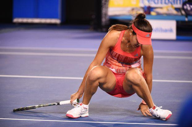 epa05114539 Ana Ivanovic of Serbia slips on court against to Anastasija Sevastova of Latvia during their second round match on day four of the Australian Open tennis tournament in Melbourne, Australia, 21 January 2016. EPA/JOE CASTRO AUSTRALIA AND NEW ZEALAND OUT