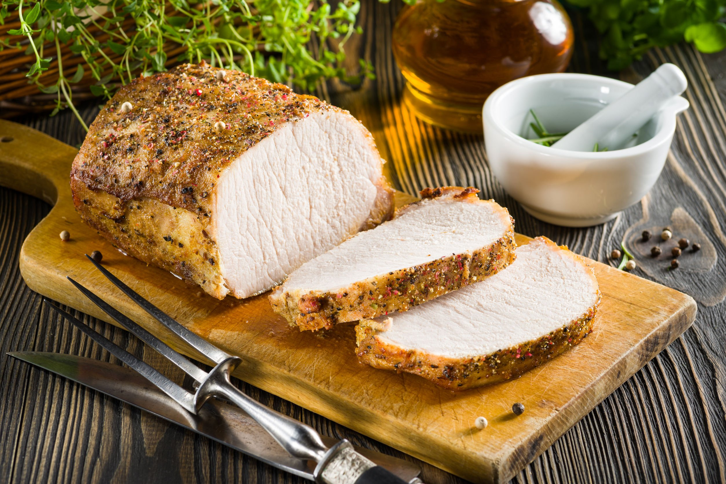 39024999 - roasted pork loin on the wooden table