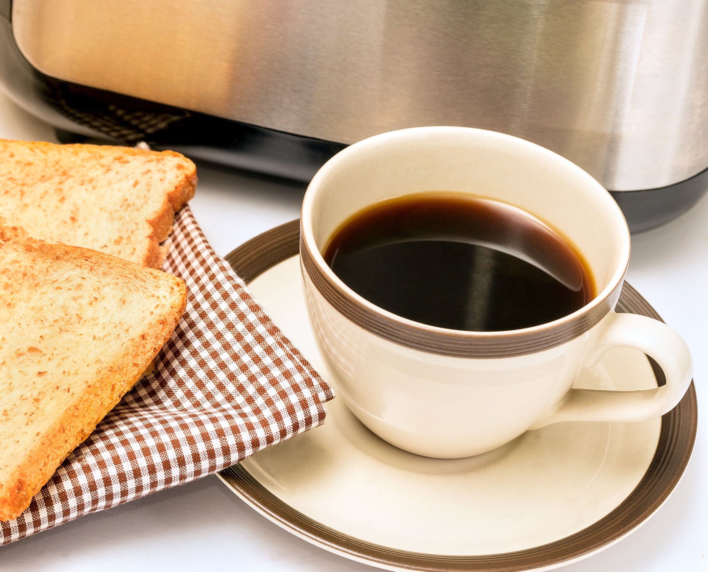 61952266 - coffee and toast showing morning meal and toasted