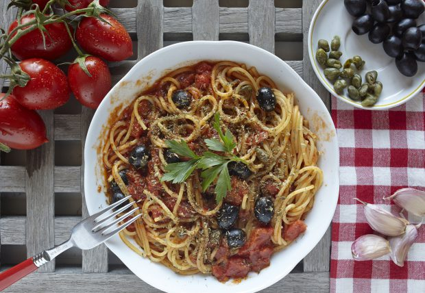 43626893 - italian food: pasta with tomatoes, olives and capers, called puttanesca