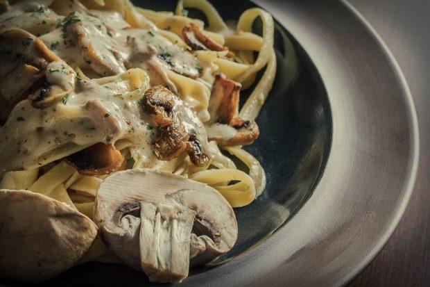 48917191 - fancy organic fetuccine pasta with creamy alfredo mushroom sauce