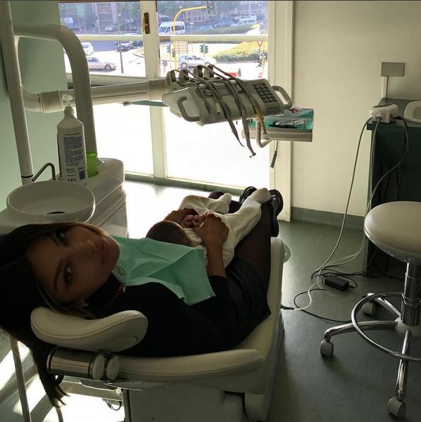 Mădălina Ghenea, on the dentist's hand. Her little girl was next to her