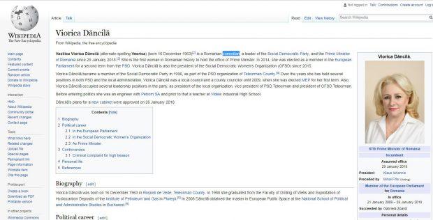 """FOTO   Pagina de Wikipedia în limba engleză a Vioricăi Dăncilă, modificată. Premierul este numit """"comediant"""""""