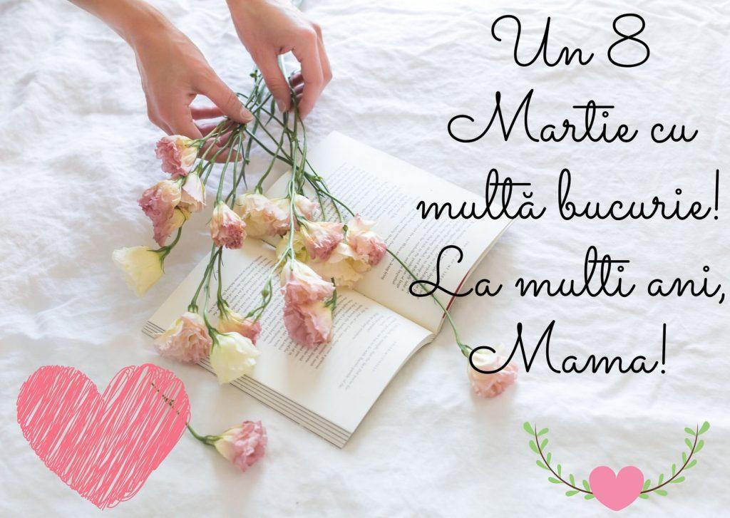 Mesaje de 8 martie pentru mama- Flori așezate cu mâna pe o carte deschisă